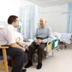 Patient and man in ward