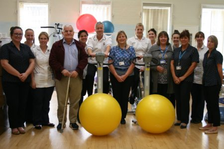 Photograph of physiotherapy staff members from Lincoln County Hospital with two patients.
