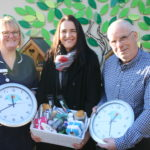 Photo of Cathie Alcock, Jane Walton and Andy Storey with the bird tables and holding the clocks. JPEG