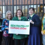 Macmillan Cancer support team with sign