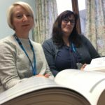 Photograph of Susan and Rebecca with their index books. JPEG