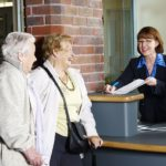 NHS patients booking in at hospital reception