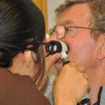 ULHT dermatologist Dr Caroline Angit examining a mark on Leonard Andrews' face