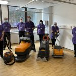 some of the team with pieces of the new cleaning equipment