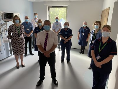 Professor Jonathan Van-Tam with staff in the Captain Sir Tom Moore Plural Procedure room as part of the new £4.5 million specialist respiratory unit for Lincolnshire patients.