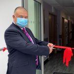 Professor Jonathan Van-Tam cuts ribbon