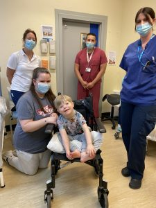 Reuben Bescoby after having his cast removed, with (L to R) Orthopaedic Practitioner, Kim Jenns, his mum Jade Bescoby, Orthopaedic Surgeon, Mohamed Hafez and Orthopaedic Practitioner, Sophie Wilkinson.